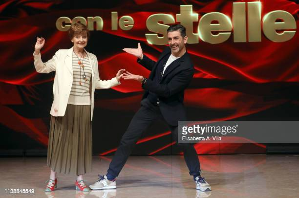 Actress Milena Vukotic and her dance partner Simone Di Pasquale attend the photocall for Ballandro Con Le Stelle at RAI Auditorium on March 28 2019...