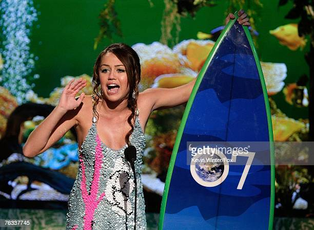 Actress Miley Cyrus accepts the 'Choice TV Actress Comedy' award for 'Hannah Montana' onstage during the 2007 Teen Choice Awards held at The Gibson...