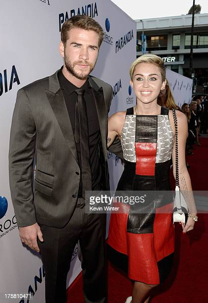 Actress Miley Cyrus and actor Liam Hemsworth attend the premiere of Relativity Media's 'Paranoia' at the DGA Theater on August 8 2013 in Los Angeles...