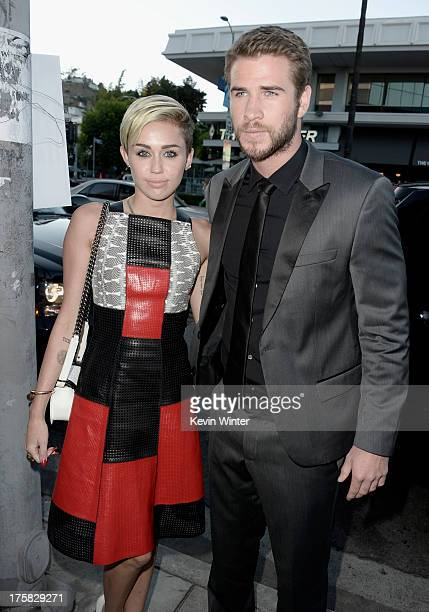 Actress Miley Cyrus and actor Liam Hemsworth attend the premiere of Relativity Media's Paranoia at the DGA Theater on August 8 2013 in Los Angeles...