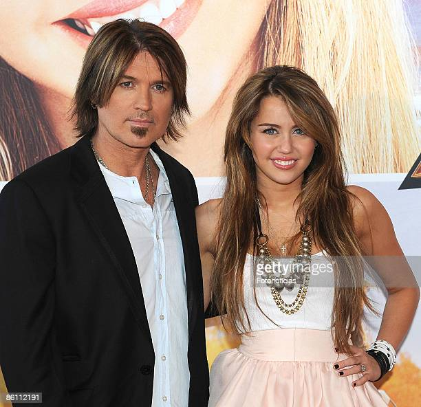 """Actress Miley Cyrus and Billy Ray Cyrus arrive at """"Hannah Montana:The Movie"""" premiere, at Kinepolis Cinema on April 21, 2009 in Madrid, Spain."""