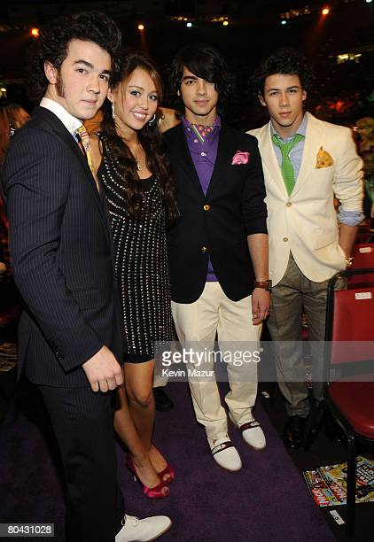 Actress Miley Cyrus and The Jonas Brothers during Nickelodeons 2008 Kids Choice Awards held at the Pauley Pavilion on March 29 2008 in Westwood...
