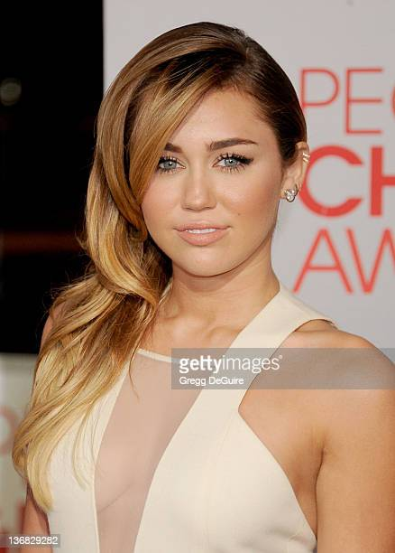 Actress Miley Cyrus arrives at 2012 People's Choice Awards at Nokia Theatre LA Live on January 11 2012 in Los Angeles California