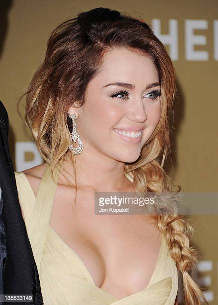 Actress Miley Cyrus arrives at the 2011 CNN Heroes An AllStar Tribute at The Shrine Auditorium on December 11 2011 in Los Angeles California