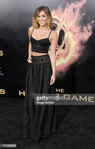 Actress Miley Cyrus arrives at The Hunger Games Los Angeles Premiere at Nokia Theatre LA Live on March 12 2012 in Los Angeles California