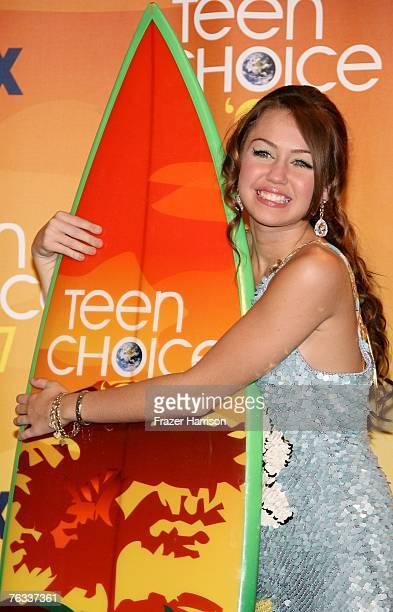 Actress Miley Cyrus poses in the press room during the 2007 Teen Choice Awards held at The Gibson Amphitheatre on August 26 2007 in Universal City...