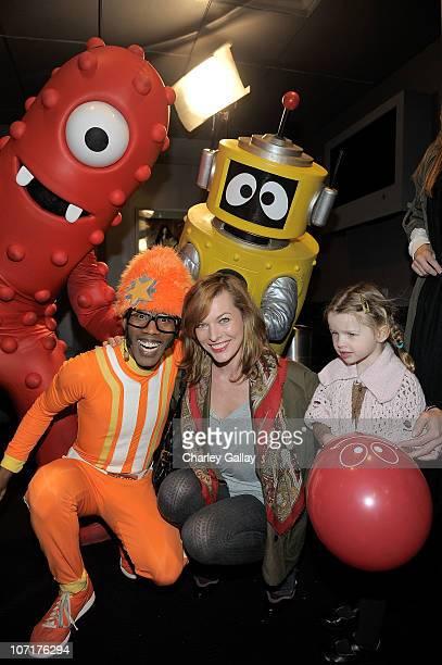 Actress Milla Jovovich and daughter Ever Gabo Anderson meet DJ Lance Rock and other YO GABBA GABBA characters backstage at YO GABBA GABBA @ KIA...