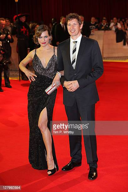 Actress Milla Jovovich and Director Paul Anderson attend the E One presents the world exclusive premiere of The Three Musketeers at Vue Westfield on...