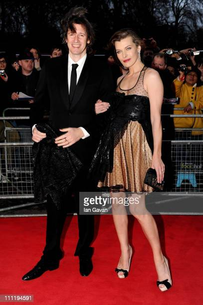 Actress Milla Jovovich and director Paul Anderson attend the Gorby 80 Gala at the Royal Albert Hall on March 30 2011 in London England The concert is...