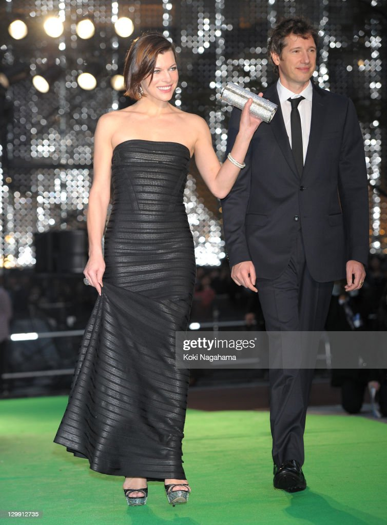 Actress Milla Jovovich and Director Paul W.S. Anderson walk on the green carpet during the Tokyo International Film Festival Opening Ceremony at Roppongi Hills on October 22, 2011 in Tokyo, Japan.
