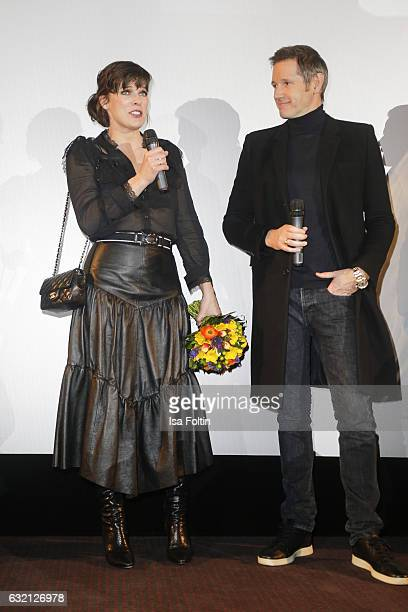 US actress Milla Jovovich and her husband producer Paul W S Anderson during the stage presentation at the Social Movie Night At 'Resident Evil The...