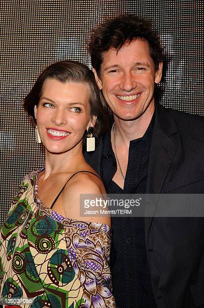 Actress Milla Jovovich and Paul W.S. Anderson attend the Marni at H&M Collection Launch at Lloyd Wright's Sowden House on February 17, 2012 in Los...