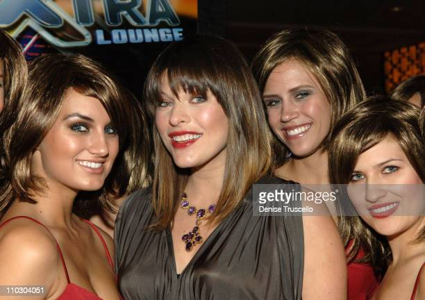 Actress Milla Jovovich and 'the 100 Alice's' pose for photos at The World Premiere of Resident Evil Extinction at The Planet Hollywood Resort Casino...