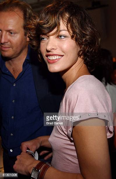 Actress Milla Jovovich attends the Donna Karan show during Olympus Fashion Week Spring 2005 at 711 Greenwich Street September 13 2004 in New York City