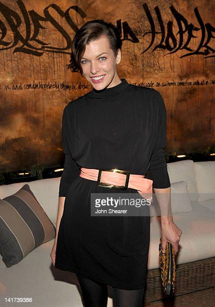 Actress Milla Jovovich attends the Restoration Hardware Spring 2012 Launch at Restoration Hardware on March 22 2012 in Los Angeles California