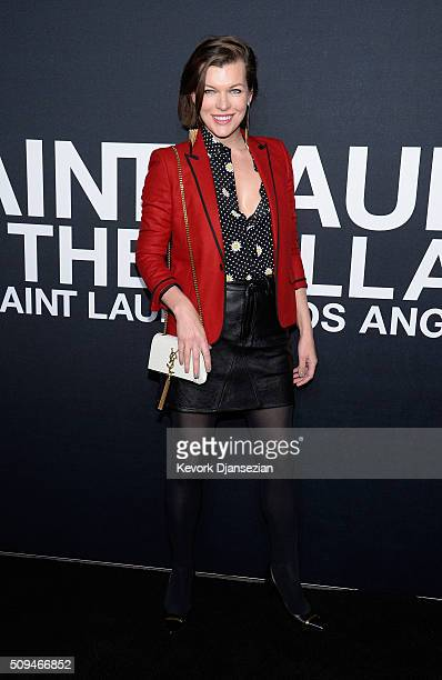 Actress Milla Jovovich attends the Saint Laurent show at The Hollywood Palladium on February 10 2016 in Los Angeles California