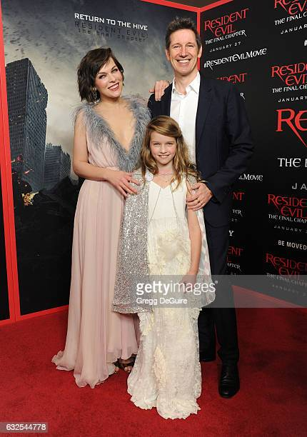 Actress Milla Jovovich husband/director Paul WS Anderson and daughter Ever Gabo Anderson arrive at the premiere of Sony Pictures Releasing's...