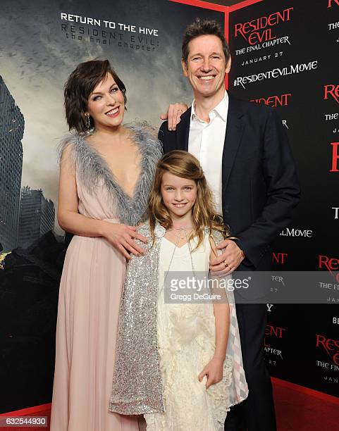 Actress Milla Jovovich husband/director Paul WS Anderson and daughter Ever Gabo Anderson arrive at the premiere of Sony Pictures Releasing's Resident...