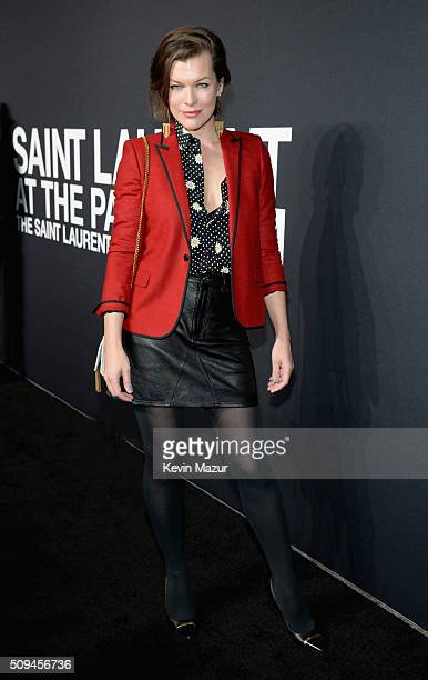Actress Milla Jovovich in Saint Laurent by Hedi Slimane attends Saint Laurent at the Palladium on February 10 2016 in Los Angeles California for the...