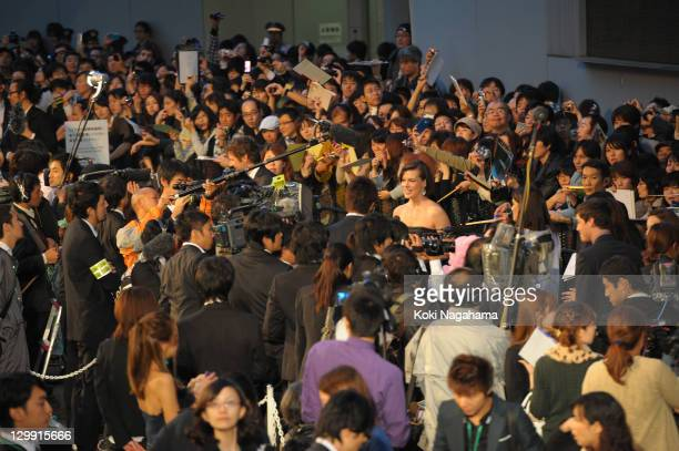 Actress Milla Jovovich is inteviewed on the green carpet during the Tokyo International Film Festival Opening Ceremony at Roppongi Hills on October...