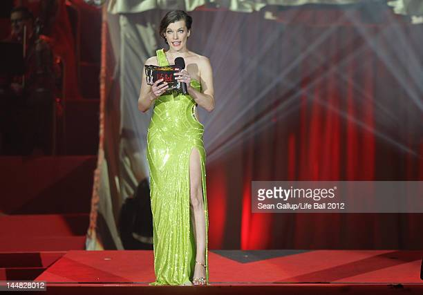 Actress Milla Jovovich speaks at the Life Ball 2012 AIDS charity fundraiser at City Hall on May 19 2012 in Vienna Austria