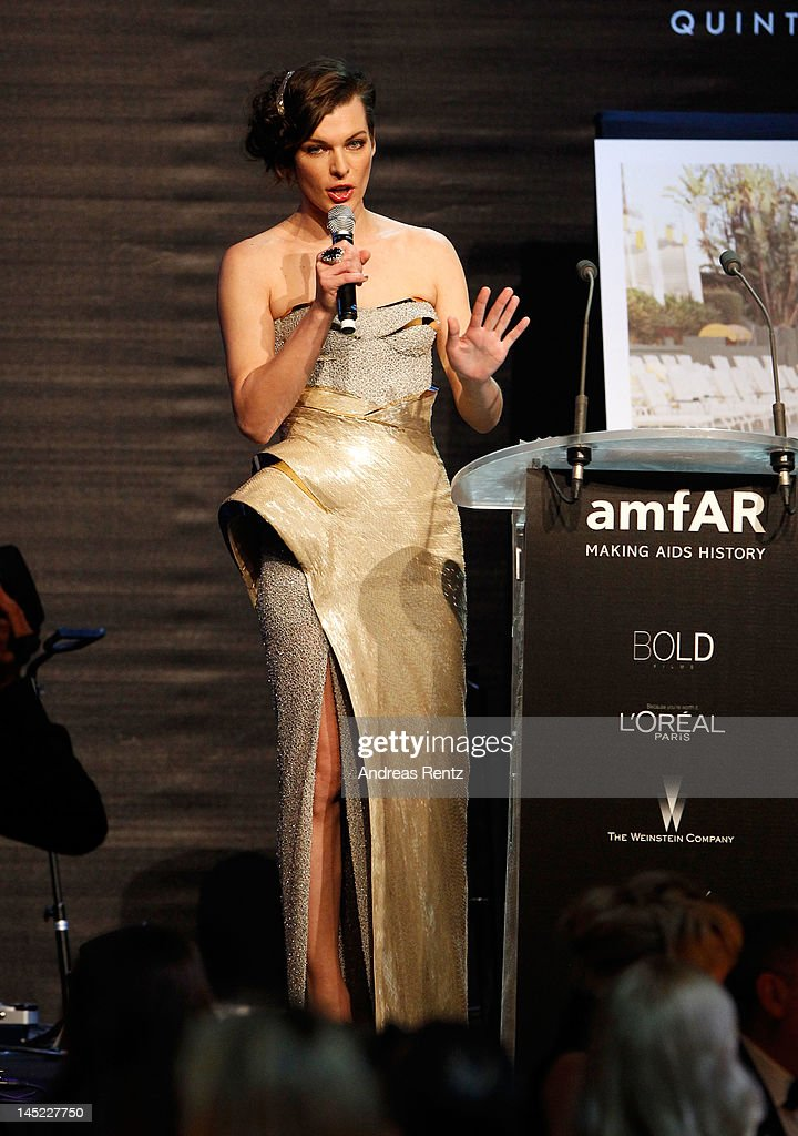 Actress Milla Jovovich speaks onstage during the 2012 amfAR's Cinema Against AIDS during the 65th Annual Cannes Film Festival at Hotel Du Cap on May 24, 2012 in Cap D'Antibes, France.