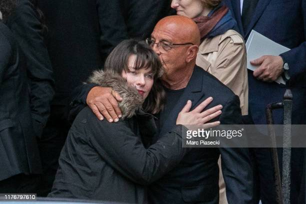 Actress Milla Jovovitch and photographer Jean-Baptiste Mondino attend Peter Lindbergh's funeral at Eglise Saint-Sulpice on September 24, 2019 in...