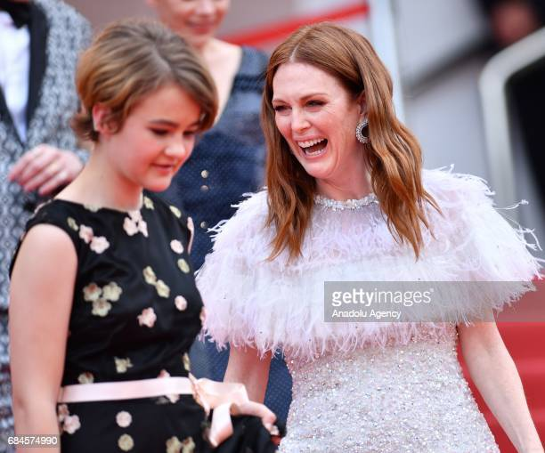 US actress Millicent Simmonds and US actress Julianne Moore leave after the film 'Wondersrtruck screening in competition at the 70th annual Cannes...