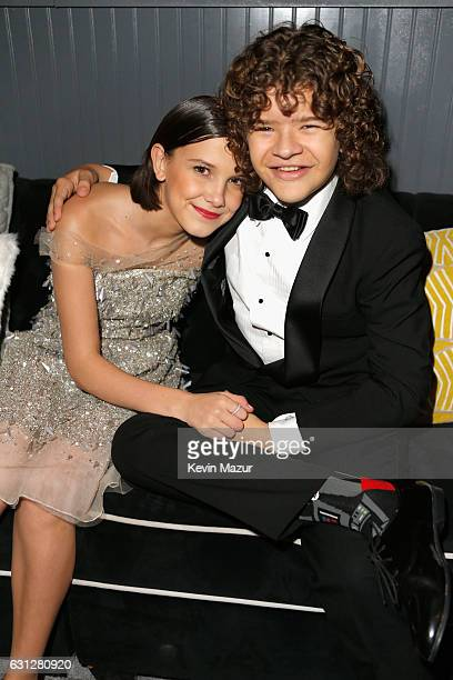 Actress Millie Bobby Brown and actor Gaten Matarazzo attend The Weinstein Company and Netflix Golden Globe Party presented with FIJI Water Grey Goose...
