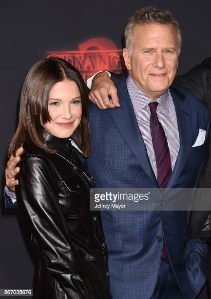 Actress Millie Bobby Brown and actor Paul Reiser arrive at the Premiere Of Netflix's 'Stranger Things' Season 2 at Regency Westwood Village Theatre...