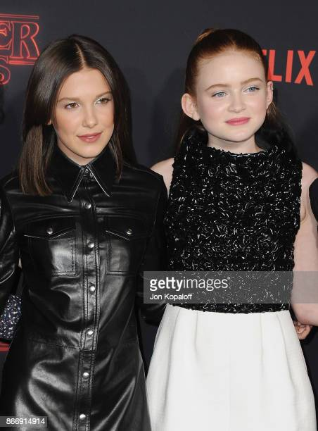 """Actress Millie Bobby Brown and actress Sadie Sink arrive at the premiere of Netflix's """"Stranger Things"""" Season 2 at Regency Bruin Theatre on October..."""