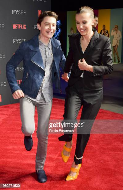 Actress Millie Bobby Brown and Noah Schnapp arrive at the #NETFLIXFYSEE event for 'Stranger Things' at Netflix FYSEE at Raleigh Studios on May 19...