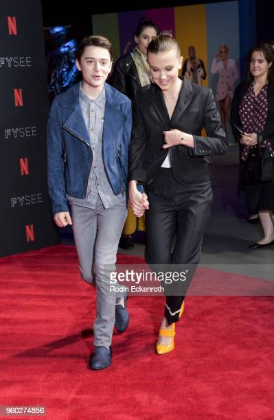 Actress Millie Bobby Brown and Noah Schnapp arrive at the #NETFLIXFYSEE event for Stranger Things at Netflix FYSEE at Raleigh Studios on May 19 2018...