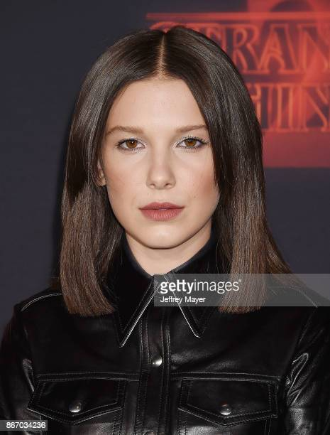 Actress Millie Bobby Brown arrives at the Premiere Of Netflix's 'Stranger Things' Season 2 at Regency Westwood Village Theatre on October 26 2017 in...