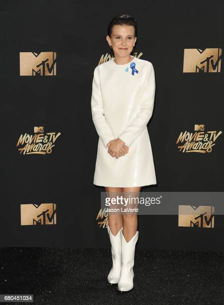 Actress Millie Bobby Brown poses in the press room at the 2017 MTV Movie and TV Awards at The Shrine Auditorium on May 7 2017 in Los Angeles...
