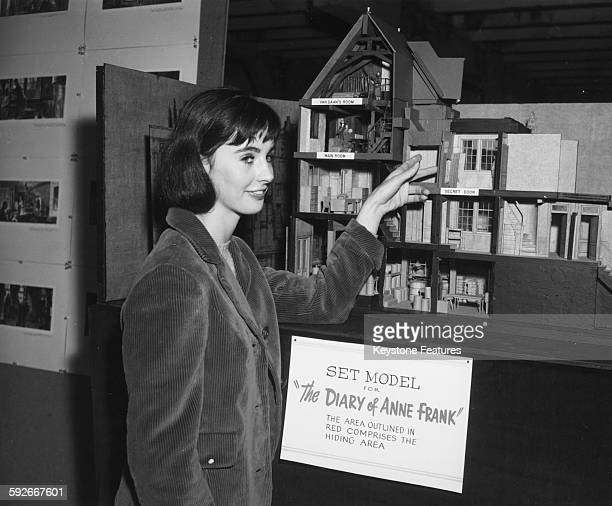 Actress Millie Perkins inspecting a set model of the house where Anne Frank and her family hid from the Nazi's for the film 'The Diary of Anne Frank'...