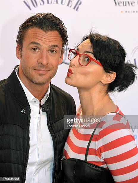 Actress Mimi Fiedler and actor Stephan Luca pose at the opening of the Diesel flagship store on September 5 2013 in Frankfurt am Main Germany