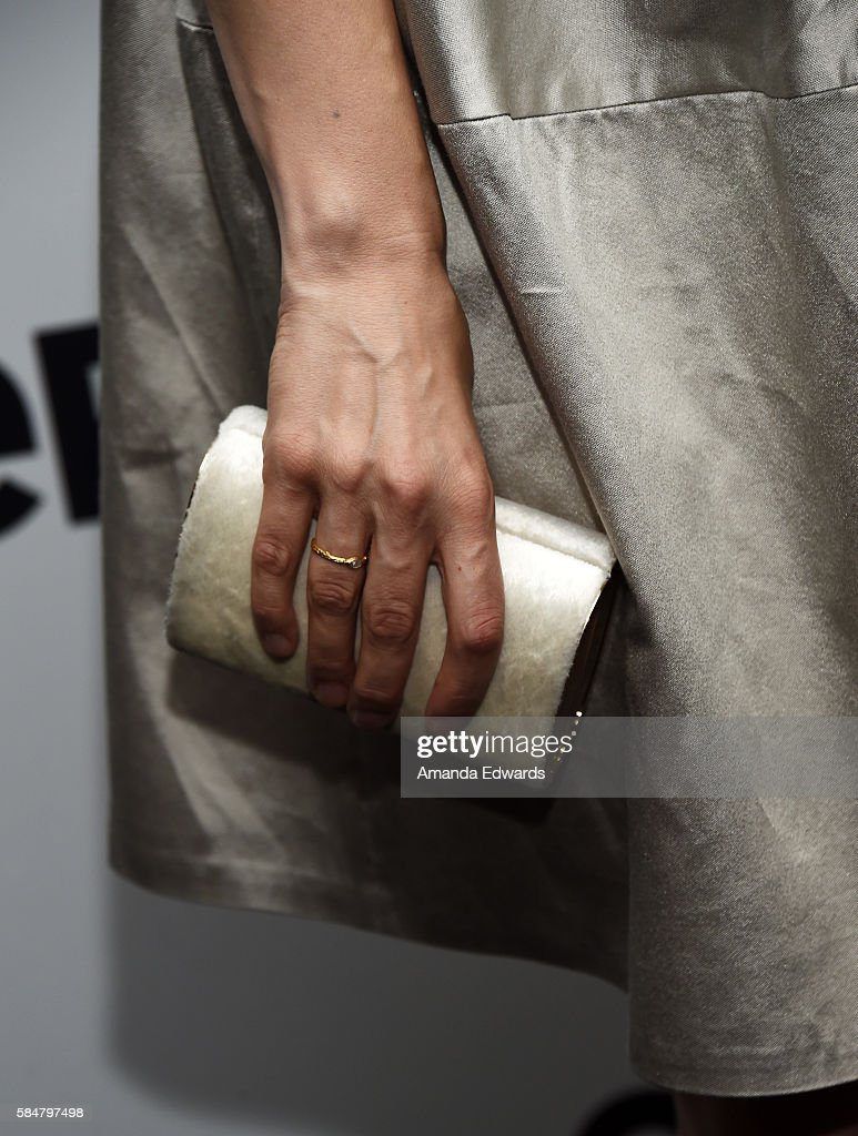 Actress Mina Tander, clutch detail, attends EPIX's Television Critics Association Tour at The Beverly Hilton Hotel on July 30, 2016 in Beverly Hills, California.
