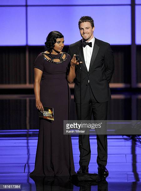 Actress Mindy Kaling and actor Stephen Amell speak onstage during the 65th Annual Primetime Emmy Awards held at Nokia Theatre LA Live on September 22...