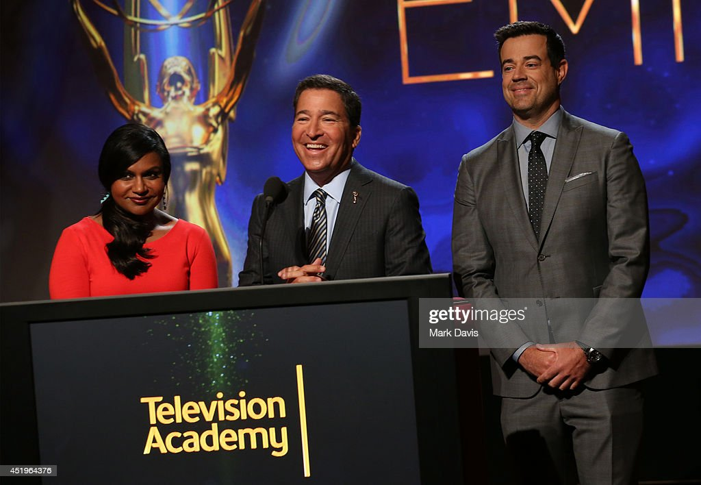 Actress Mindy Kaling, Television Academy Chairman and CEO, Bruce Rosenblum and TV personality Carson Daly speak onstage at the 66th Primetime Emmy Awards Nominations at Leonard H. Goldenson Theatre on July 10, 2014 in North Hollywood, California.