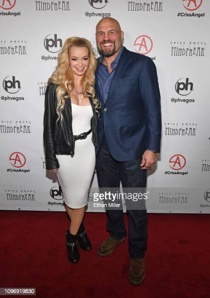 Actress Mindy Robinson and actor and UFC Hall of Fame member Randy Couture attend the grand opening of 'Criss Angel MINDFREAK' at Planet Hollywood...