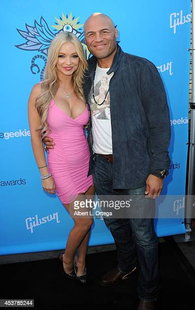 Actress Mindy Robinson and actor/fighter Randy Couture arrive for The Geekie Awards 2014 held at Avalon on August 17 2014 in Hollywood California