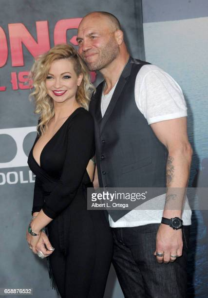 Actress Mindy Robinson and actor/fighter Randy Couture arrive for the Premiere Of Warner Bros Pictures' Kong Skull Island held at Dolby Theatre on...