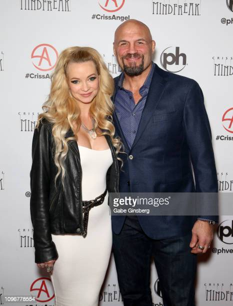Actress Mindy Robinson and UFC Hall of Fame member Randy Couture attend the grand opening of 'Criss Angel MINDFREAK' at Planet Hollywood Resort...