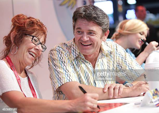 Actress Mindy Sterling and actor John Michael Higgins sign autographs at the Legend of Korra signing at the 2014 San Diego ComicCon International Day...