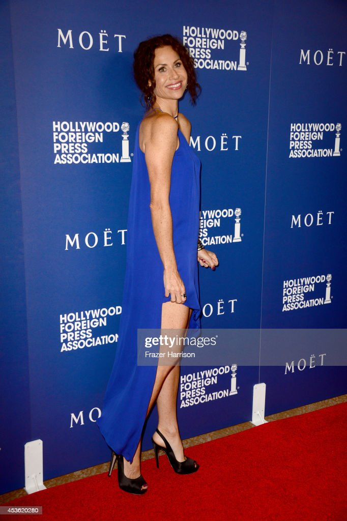 Actress Minnie Driver attends the Hollywood Foreign Press Association's Grants Banquet at The Beverly Hilton Hotel on August 14, 2014 in Beverly Hills, California.