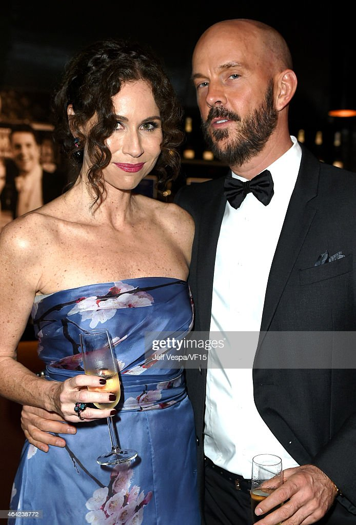 Actress Minnie Driver (L) guest attend the 2015 Vanity Fair Oscar Party hosted by Graydon Carter at the Wallis Annenberg Center for the Performing Arts on February 22, 2015 in Beverly Hills, California.
