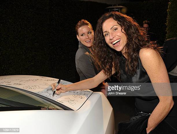 Actress Minnie Driver signs a Chrysler 300 at Vanity Fair Campaign Hollywood 2011 continues with the Richard Mille Toasts Fox Searchlight Films held...