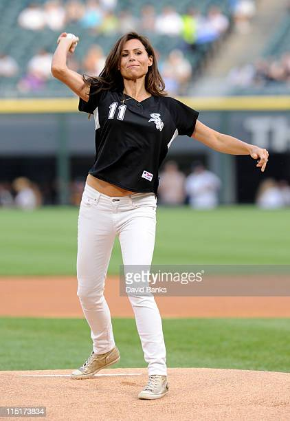 Actress Minnie Driver throws out the first pitch at the Chicago White Sox Detroit Tigers game on June 3 2011 at US Cellular Field in Chicago Illinois