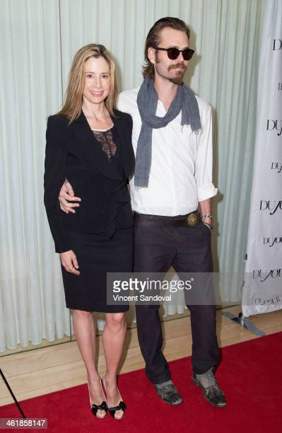 Actress Mira Sorvino and actor Christopher Backus attend the DuJour Magazine celebrates great performances issue featuring 12 Years A Slave Golden...